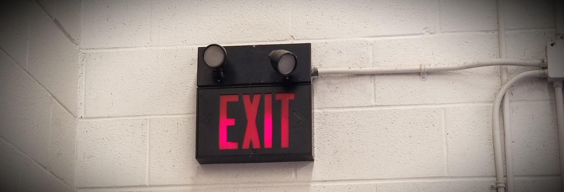 Exit sign inside a building on a wall