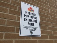 Sign showing Internet Purchase Exchange Zone