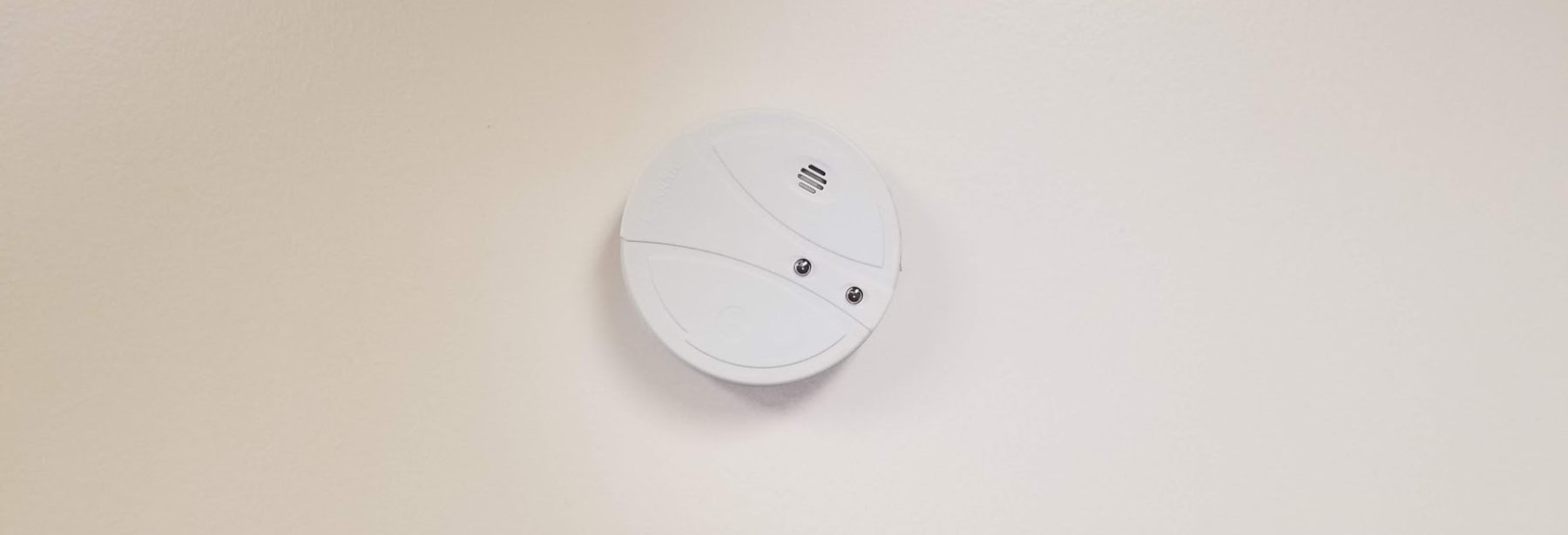 smoke alarm on a ceiling